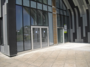 Two years after it was built, there is still an empty shop unit on the corner of the site right by Woolwich New Road