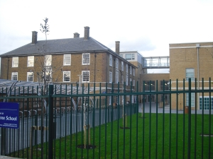 Greenwich Free School's pedestrian new buildings. The handsome 1930s Adair House has been restored but is not improved by the extensions built on two sides, which look like cheap blocks of flats thrown up by a slum landlord
